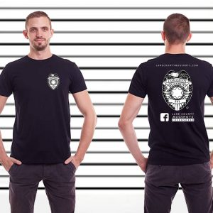 Black T-Shirt has the lane county mugshots logo on the left chest side and a large version of the logo on the back.